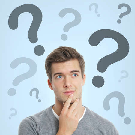 pensive young man with question marks above his head
