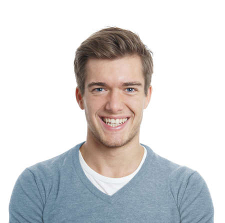 happy young man with big toothy smile isolated on white