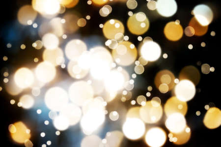 resembling: dark bokeh background resembling a defocused night sky with glittering lights Stock Photo