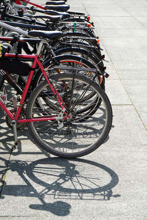 nonpolluting: row of bikes parked at a bicycle stand or rack