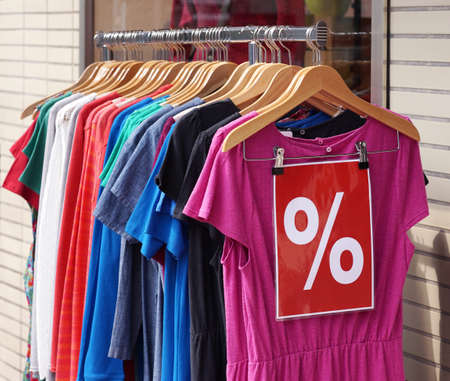 womens clothing: clearance sale clothes rack with a selection of fashion for women Stock Photo