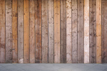 boarded: sidewalk and boarded up wall with weathered wooden planks as background