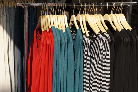 clothes rack: clothes rack with a selection of sweater fashion for women Stock Photo