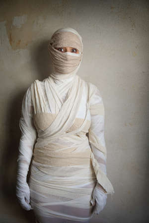 woman wrapped in bandages as egyptian mummy halloween costume
