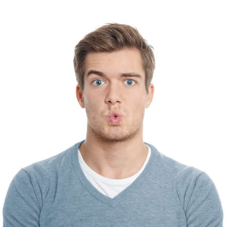 surpised young man with funny facial expression Stock Photo