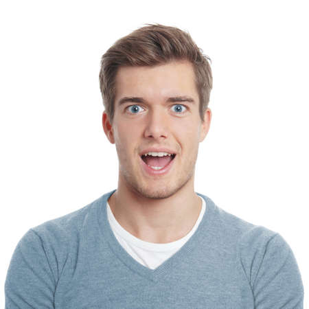 surprised man: young man looking pleasantly surprised with open mouth Stock Photo