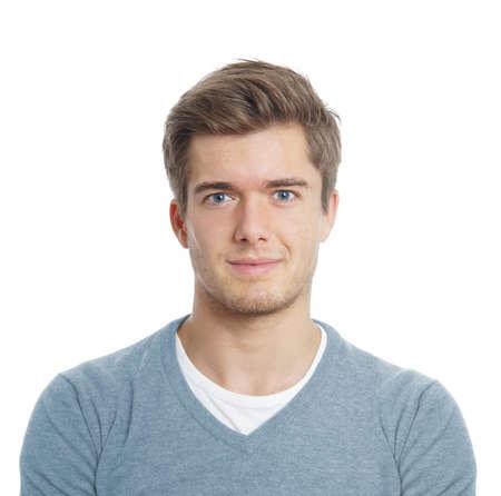 満足している肯定的な表現を探して笑顔の若い男 写真素材