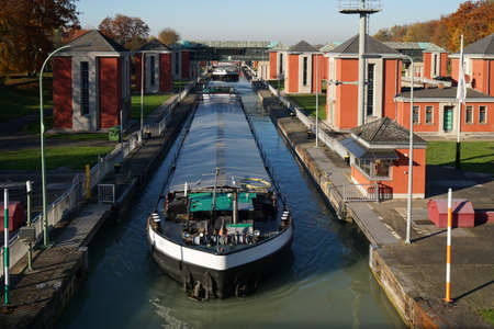 canal lock: barges at Hindenburgschleuse canal lock in Hannover, Germany Stock Photo