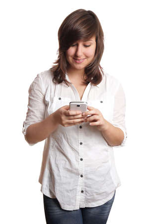 pleased: young woman looking pleased at her smartphone