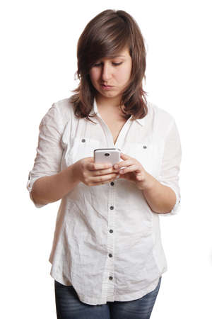 bad news: unhappy young woman reading bad news on her smartphone Stock Photo
