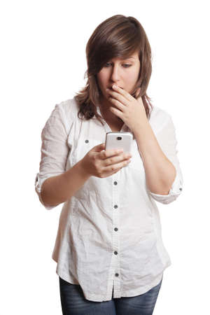 disbelief: shocked young woman staring at smartphone in disbelief Stock Photo