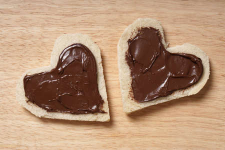 sandwich spread: two heart shaped bread slices with chocolate spread for Valentines day