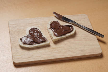 spread: two heart shaped bread slices with chocolate spread for Valentines day