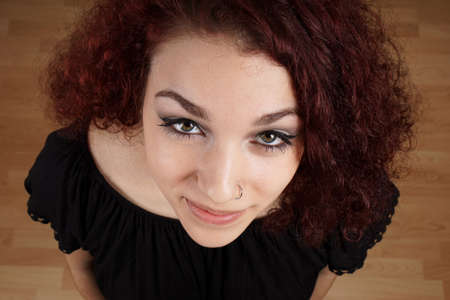 nose ring: wide high angle view of beautiful young woman looking up at camera