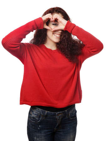 white heart: girl peeking through fingers making heart shape hand sign love symbol