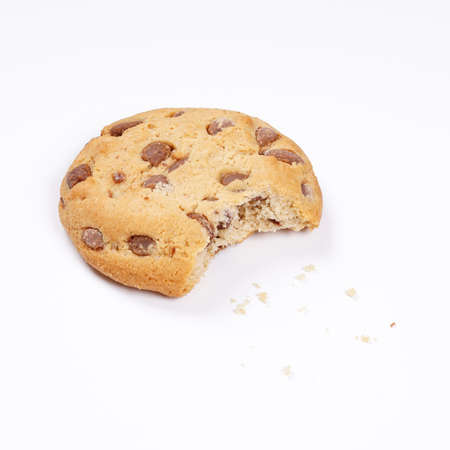 bickie: chocolate chip cookie bitten into with crumbs on white