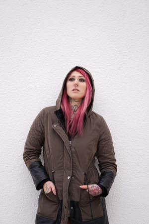 style woman: young alternative woman with pink hair piercings and tattoos Stock Photo