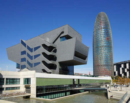 regeneration: Barcelona, Spain - March 02, 2016: The Disseny Design Museum of Barcelona, opened in 2014, and Torre Agbar skyscraper, opened in 2005, are both part of an urban regeneration project. Editorial