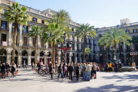 guided: Barcelona, Spain - March 02, 2016: Placa Reial populated by large groups of tourists on guided sightseeing tours.