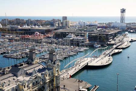 rambla: Barcelona, Spain - March 01, 2016: Aerial view of Port Vell and Barceloneta with Rambla de Mar bridge, Darsena Nacional marina and Maremagnum shopping mall. Editorial