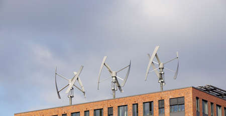 viento: wind power generator turbines on an urban building roof