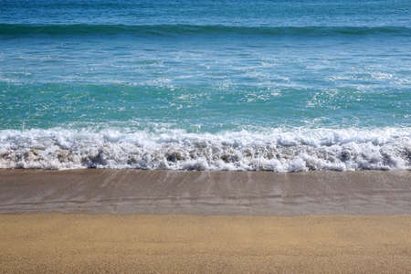 coastal: seaside background, ocean wave on sandy beach