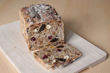 fruitcake: whole-grain fruit and nut bread from Germany on wooden board