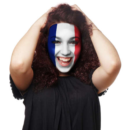 female soccer: girl with french flag face paint. female soccer fan from france