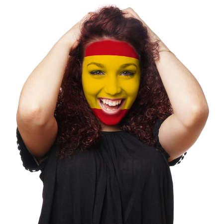 female soccer: girl with spanish flag face paint. female soccer fan from spain Stock Photo