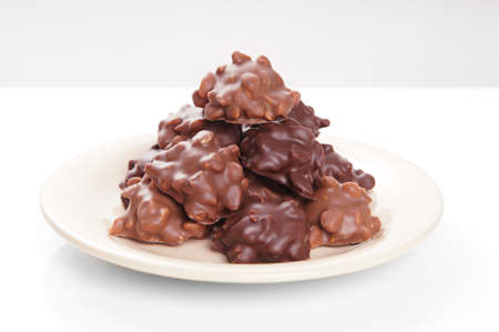 choc: nut chocolates piled on plate with selective focus