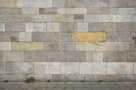 stone floor: weathered natural stone wall background with copy space Stock Photo