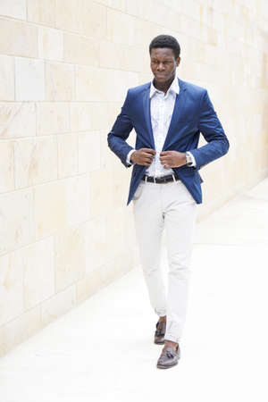 mens fashion: young african man wearing smart casual mens fashion