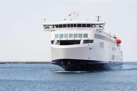 rostock: Rostock, Germany - May 30th, 2016: The brand new Scandlines hybrid ferry ship Berlin arriving in Rostock Warnemunde from Gedser in Denmark.