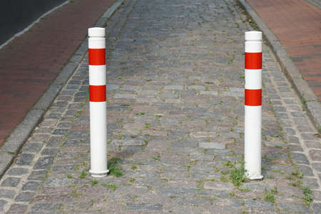 bollards: bollards on traffic-calmed city street blocking road for car traffic