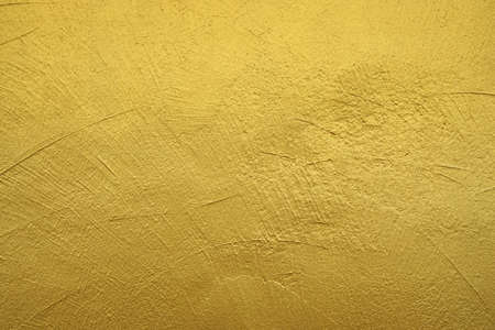 Wall Painted With Gold Color. Textured Background. Stock Photo ...