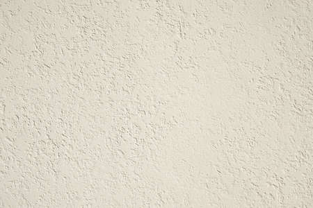 roughcast: roughcast plaster wall background texture in off-white Stock Photo