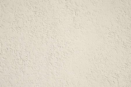 roughcast plaster wall background texture in off-white Standard-Bild
