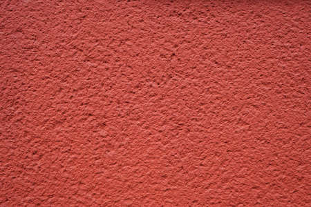 roughcast: roughcast plaster wall background texture in red