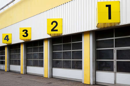 warehouse building: industrial warehouse building with numbered roll-up doors