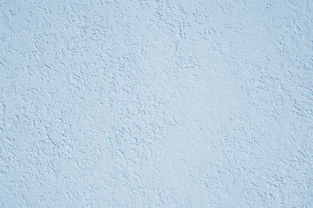 roughcast plaster wall background texture in light blue