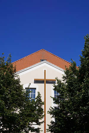 spiritualism: modern evangelist methodist church building with large christian cross in Hannover, Germany