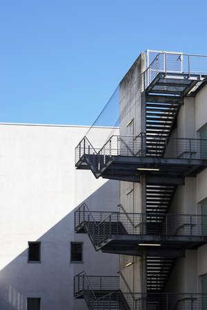 fire escape: back of building with external fire exit stairs of outside fire escape staircase