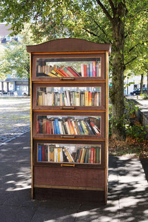 Bookcase: Hannover, Germany - September 7, 2016: A public bookcase serves as a free open air library. Editorial