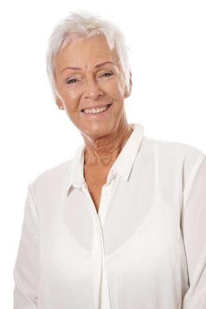 age 60: confident mature woman in her sixties wearing white blouse