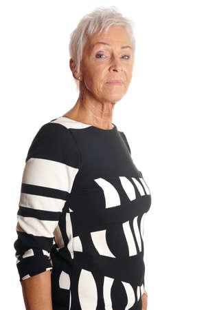 age 60: serious senior woman with short white hair. isolated on white. Stock Photo
