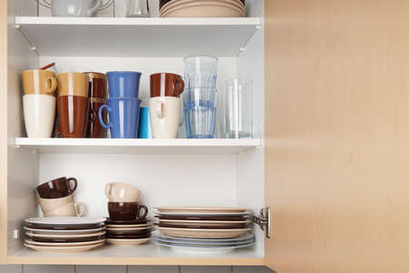 kitchen cabinet or cupboard for dishes with copy space Stock Photo