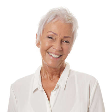 short haircut: happy smiling older lady in her sixties with trendy white short haircut Stock Photo