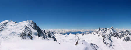 top mountain: panoramic view of snowcapped mountain peaks at Chamonix Mont Blanc in France Stock Photo