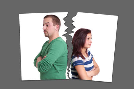 ripped up photograph of young couple. break-up, separation or divorce concept.
