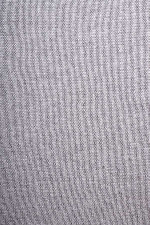 knitwear: gray knitted background, close-up of grey knitwear sweater Stock Photo